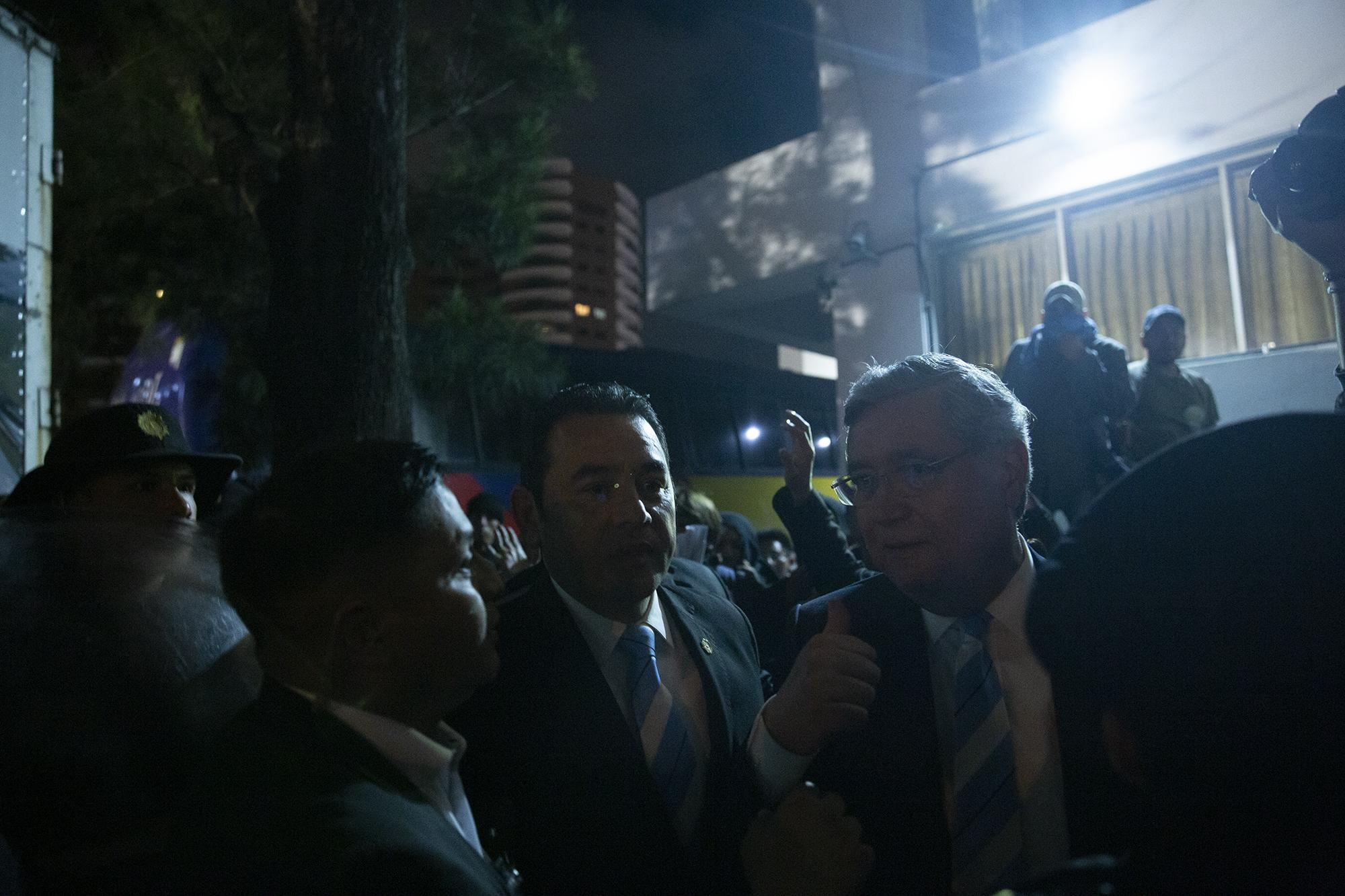 Photo caption: Former president Jimmy Morales tried to flee from protestors attempting to block him from reaching his inauguration as a Guatemalan representative to Parlacen on January 14, 2020. The protestors managed to hit Morales and pelt him with eggs. Photo by Carlos Barrera.