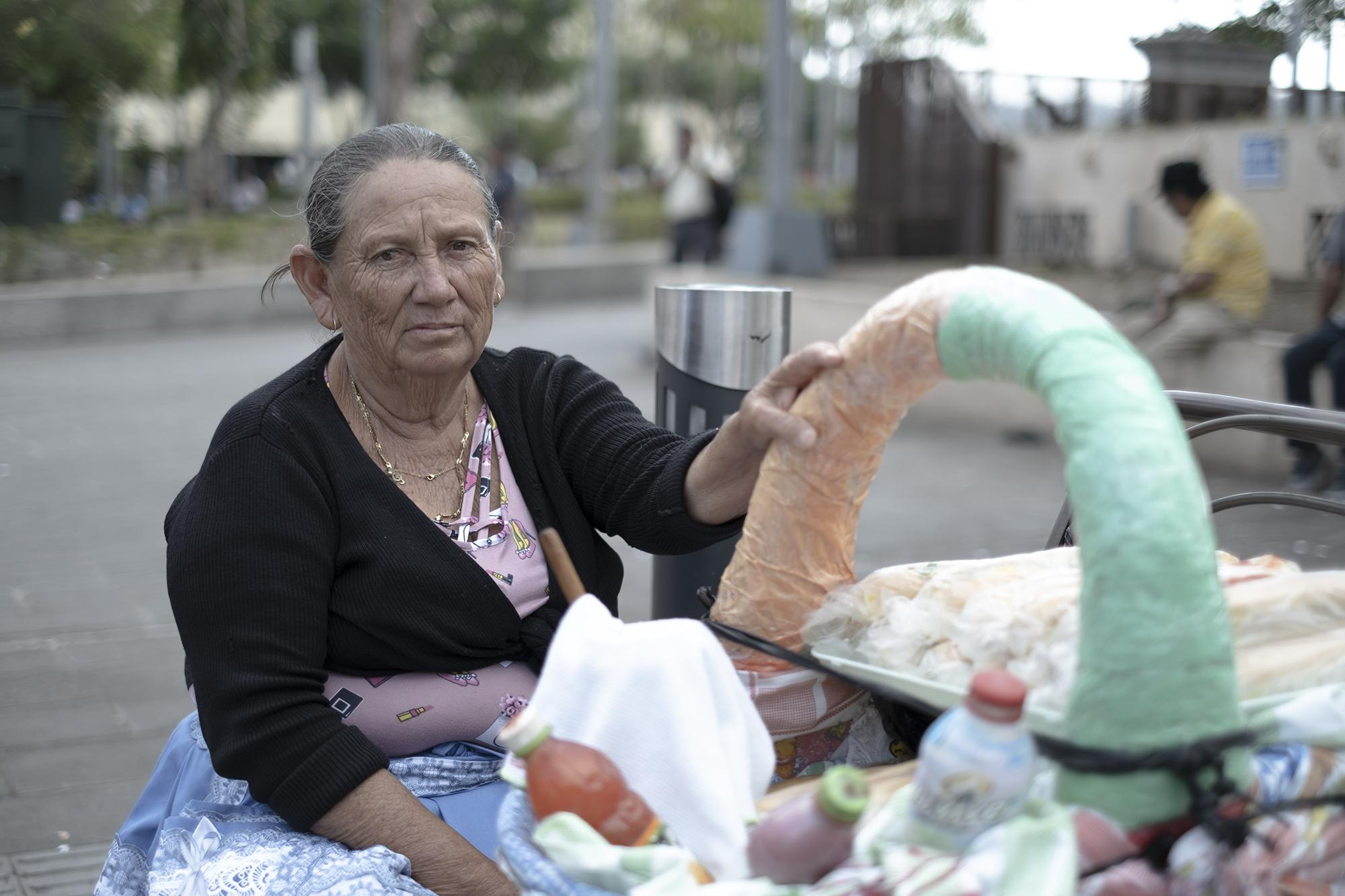 "María Mejía, 64, lives in Amatepec, Soyapango. Her only source of income is selling panes mata niños, popular street breads topped with cabbage, mortadella, and salsa. ""I sell $20 of product per day, and take home about $5 after overhead costs,"" she said. ""It's complicated with the coronavirus, but if I stay home, I'll starve."""