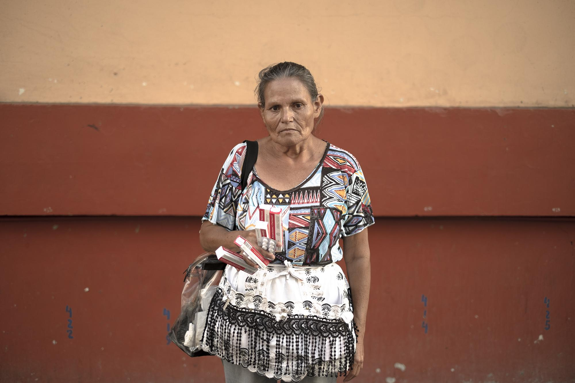 "Marta Mejía, 64, lives in Apopa and sells medicine on foot. ""I haven't sold anything here today. You roll the dice on a meal every day,"" she said. ""Can you imagine what would happen to us if we didn't go out and sell? They would let us die, because we have no other source of income."""