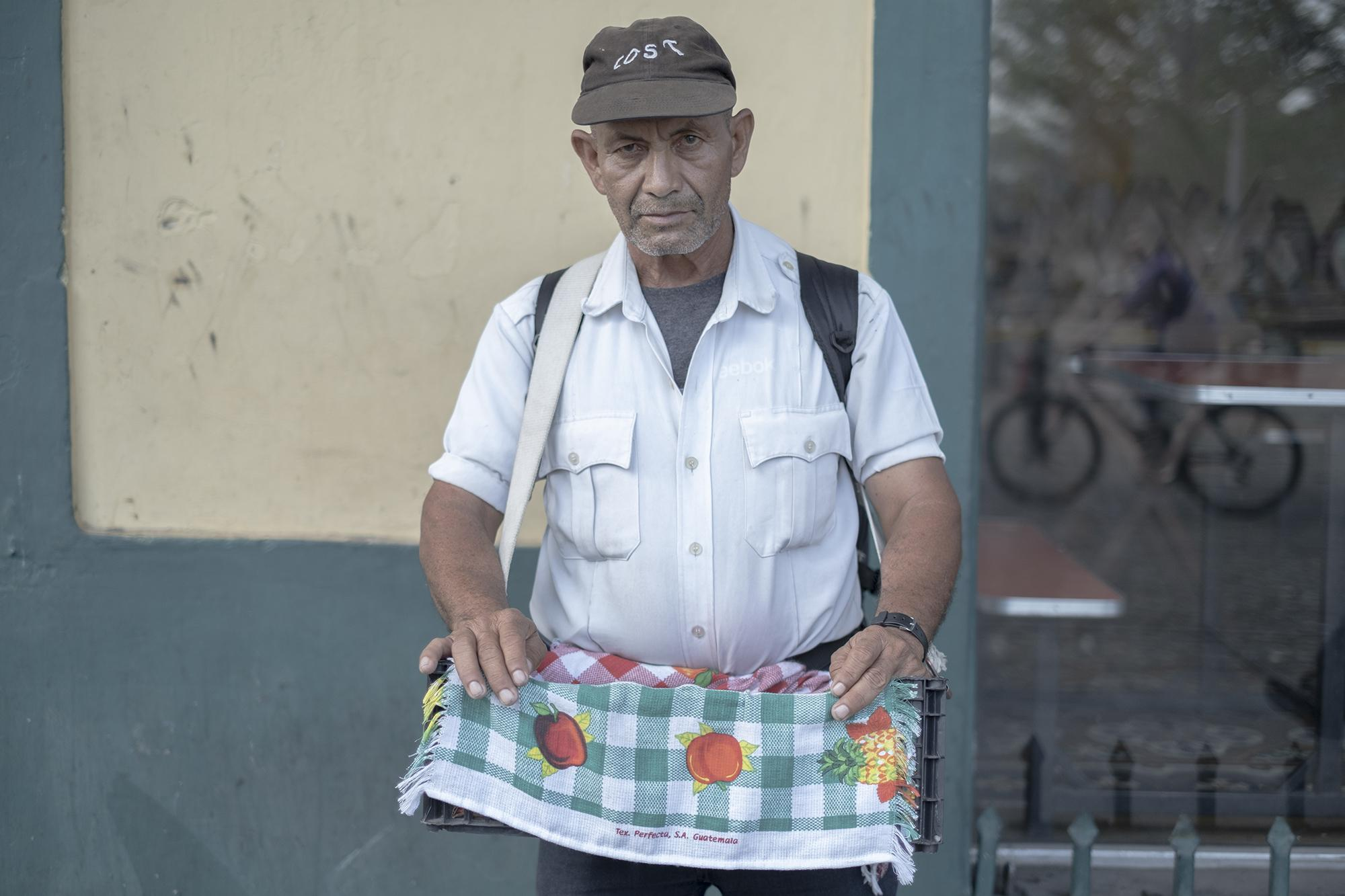 "José Alas, 57, sells candy and cigarettes downtown. He almost always makes $5 per day, $3 of which go to paying for housing. ""If I don't leave home, I can't work to pay my rent—even worse, I won't eat. Necessity makes you work,"" he said."