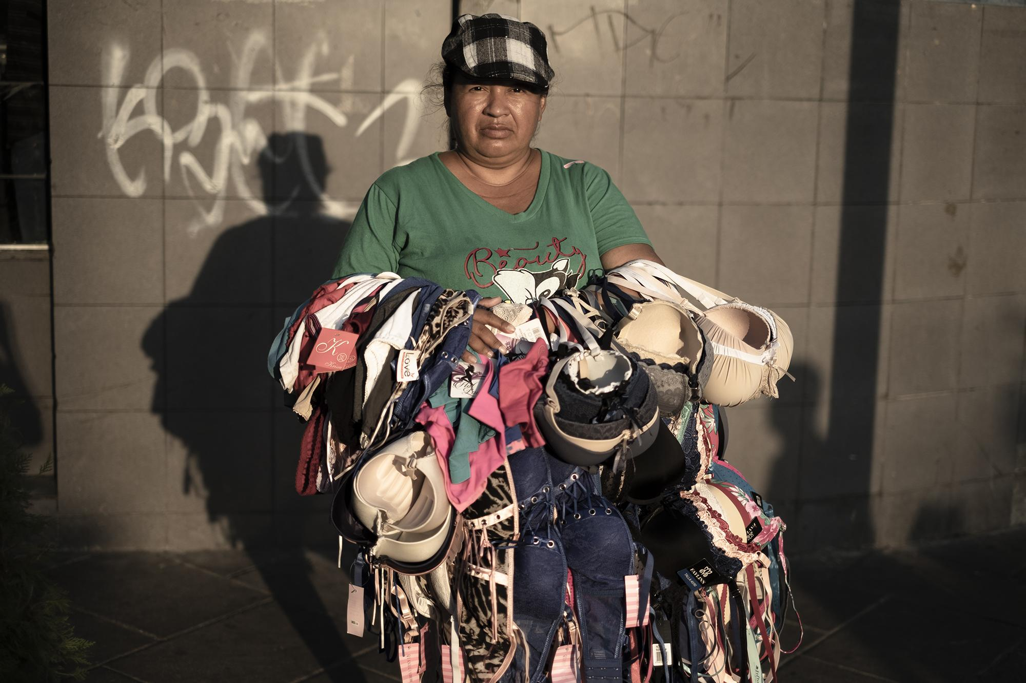 "Delmy Cornejo, 43, lives in the San Antonio neighborhood of Soyapango and travels on foot as a lingerie vendor, earning $10 on a good day. ""They'll have to pull us off the job by force,"" she said. ""You have to earn your meal every day. People with money buy things for their stashes, but we can't even get to the supermarket."""
