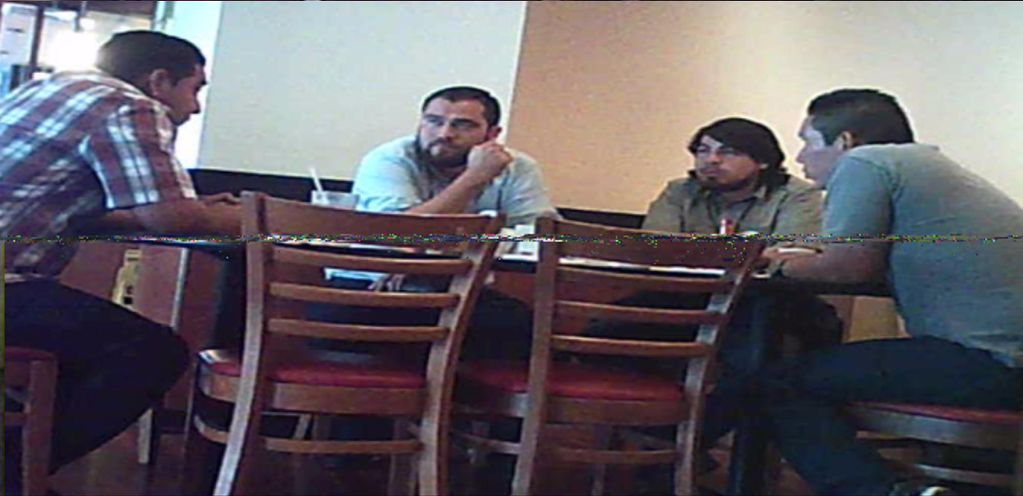 In 2015, the Police mounted 50 surveillance operations targeting gang leaders. In the course of one of these operations, on December 21, 2015, agents photographed Minister Mario Durán (then-councilman, center-left) and Carlos Marroquín (then-employee of the Mayor's Office, center-right) with Renuente (far-left, checkered shirt) and White of Iberias (far right), of the Mara Salvatrucha. El Faro archival photo obtained from National Civil Police.