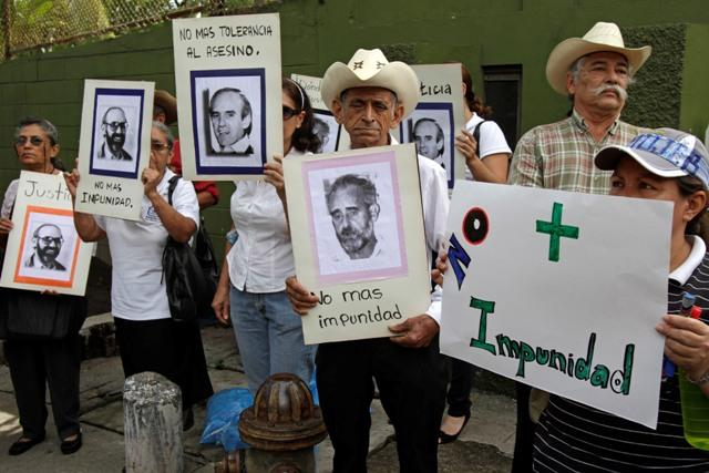 In August of 2011, 13 members of the Salvadoran military wanted by Spain for the killing of Jesuit priests took cover at a military base in San Salvador. In this picture, protesters demand that they be captured.