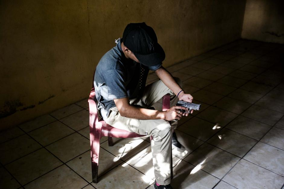 A 15-year-old gang member with a gun in a house in La Paz in July.